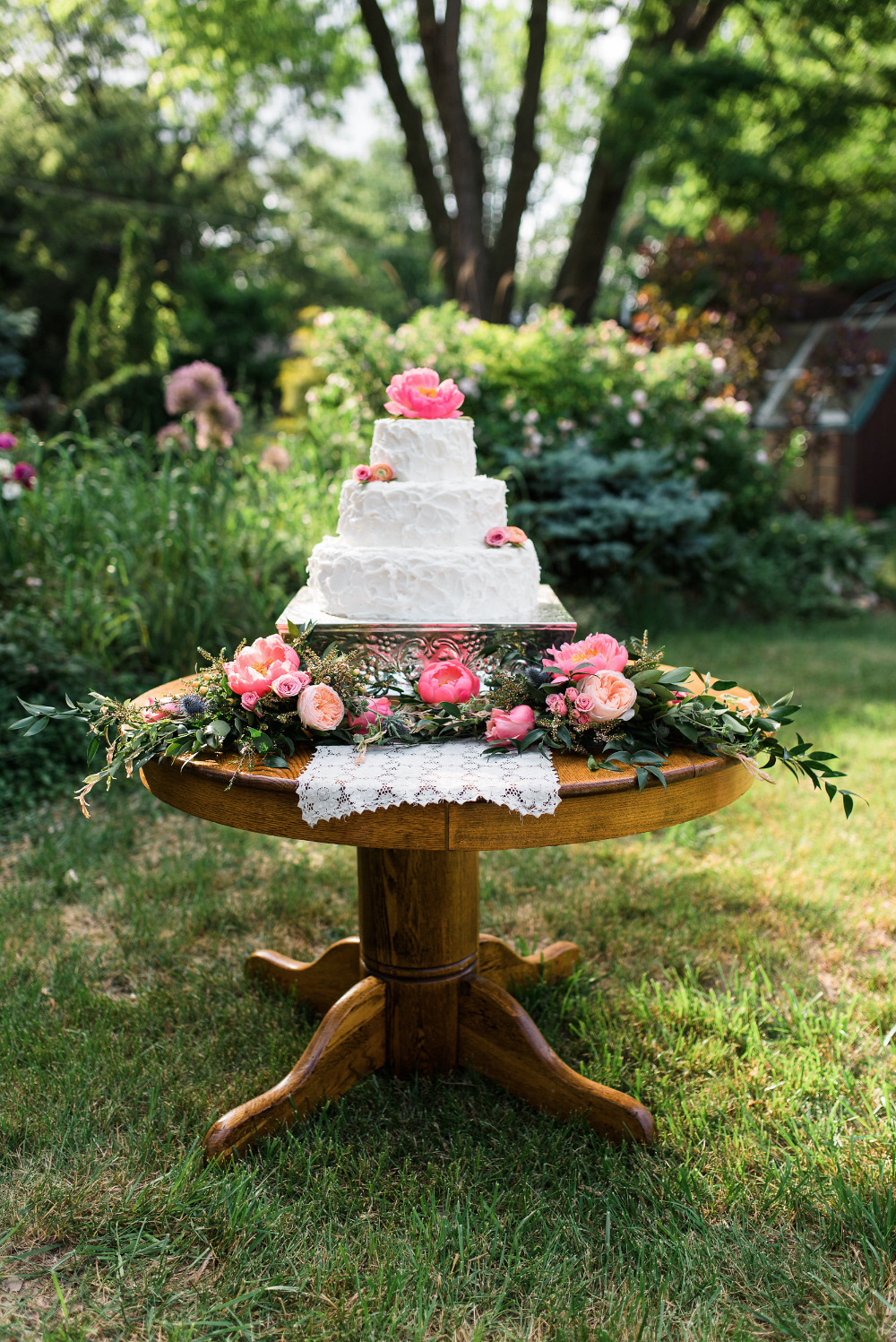 flower filled wedding cake table