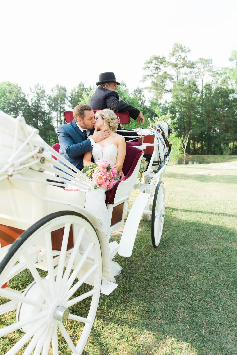 Wedding carriage kiss