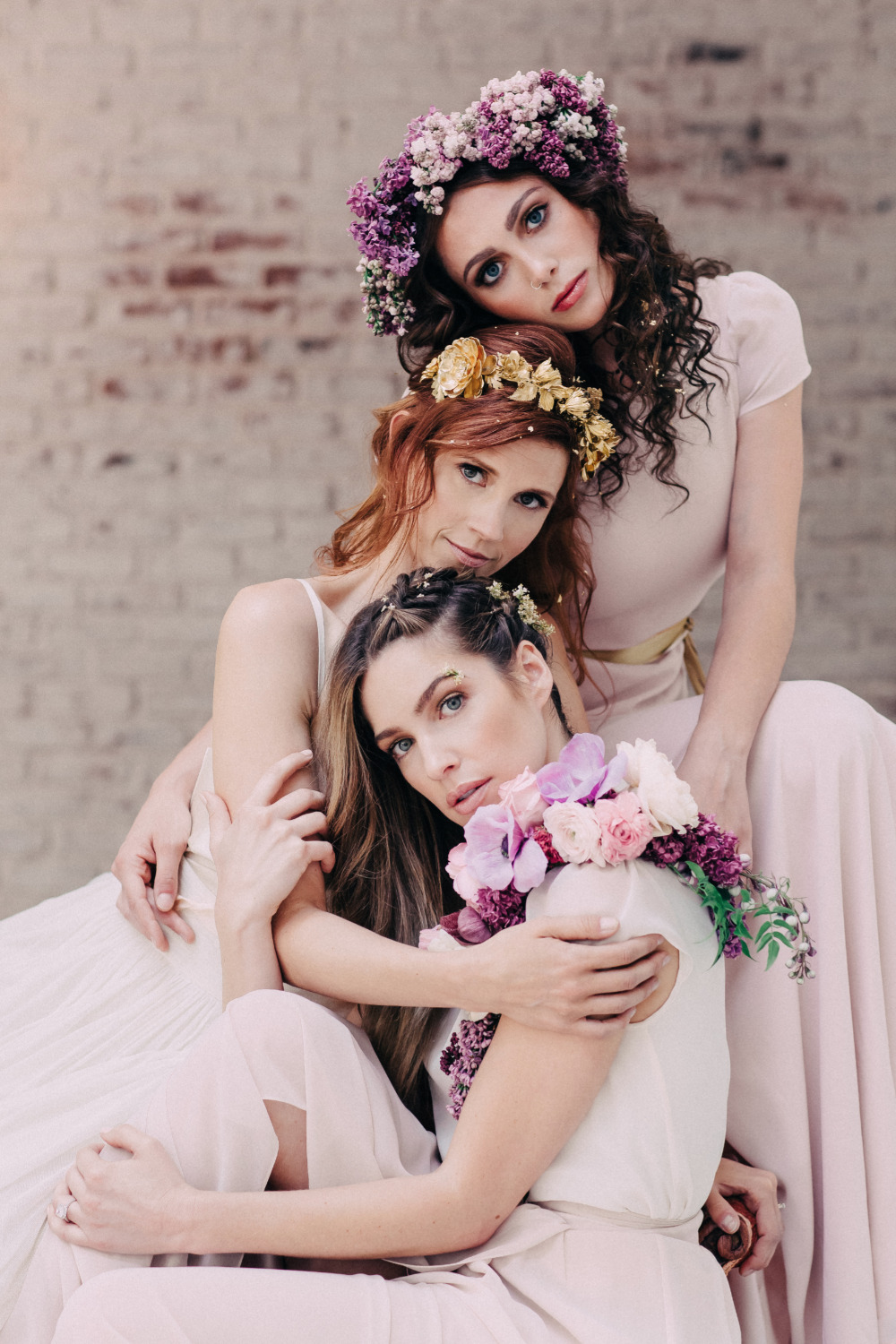 pink bridesmaid dresses with flower and gold accessories