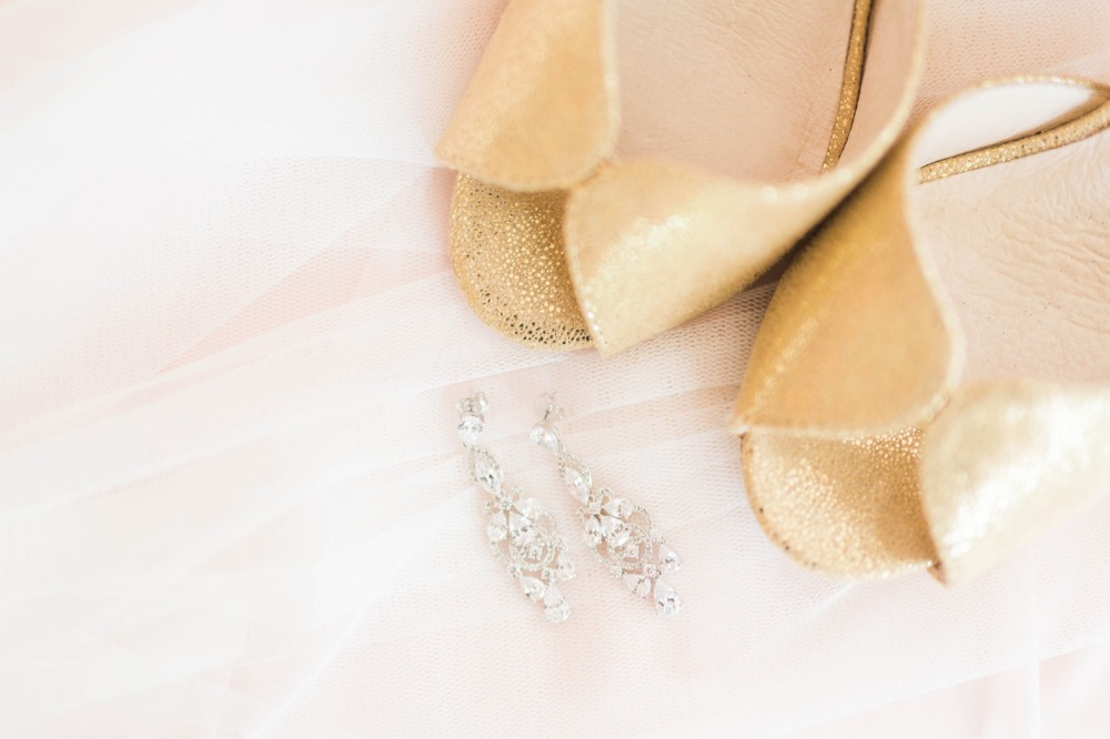 Gold heels and sparkly earrings