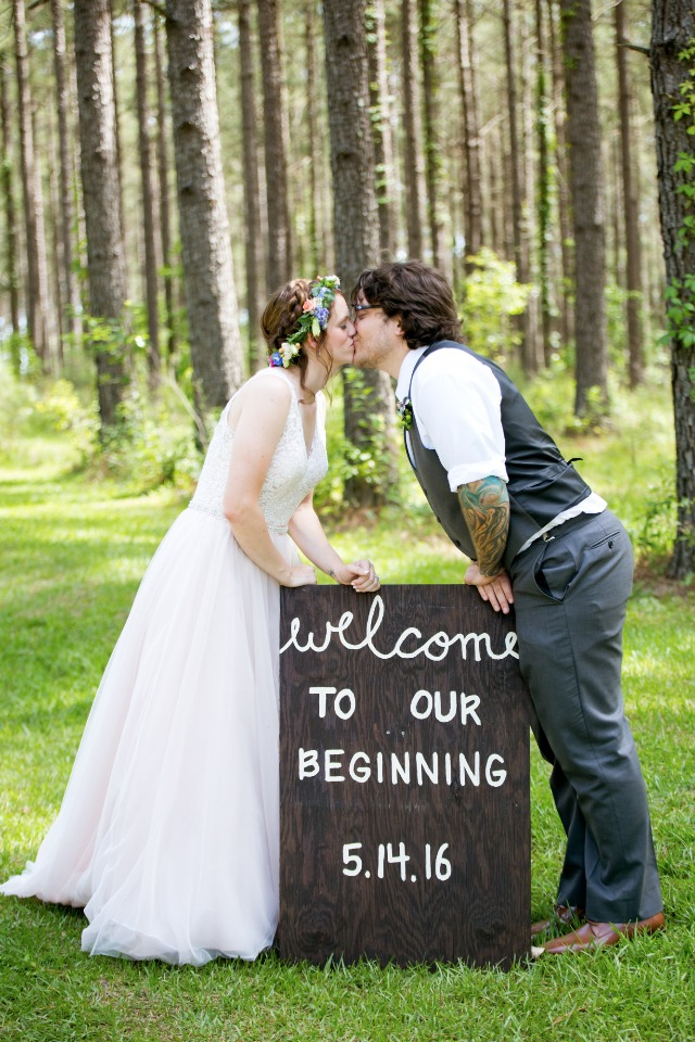 wedding kiss and super cute wedding sign