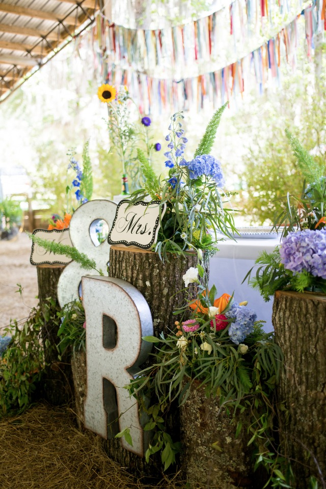 hand sawn stumps and colorful floral reception decor