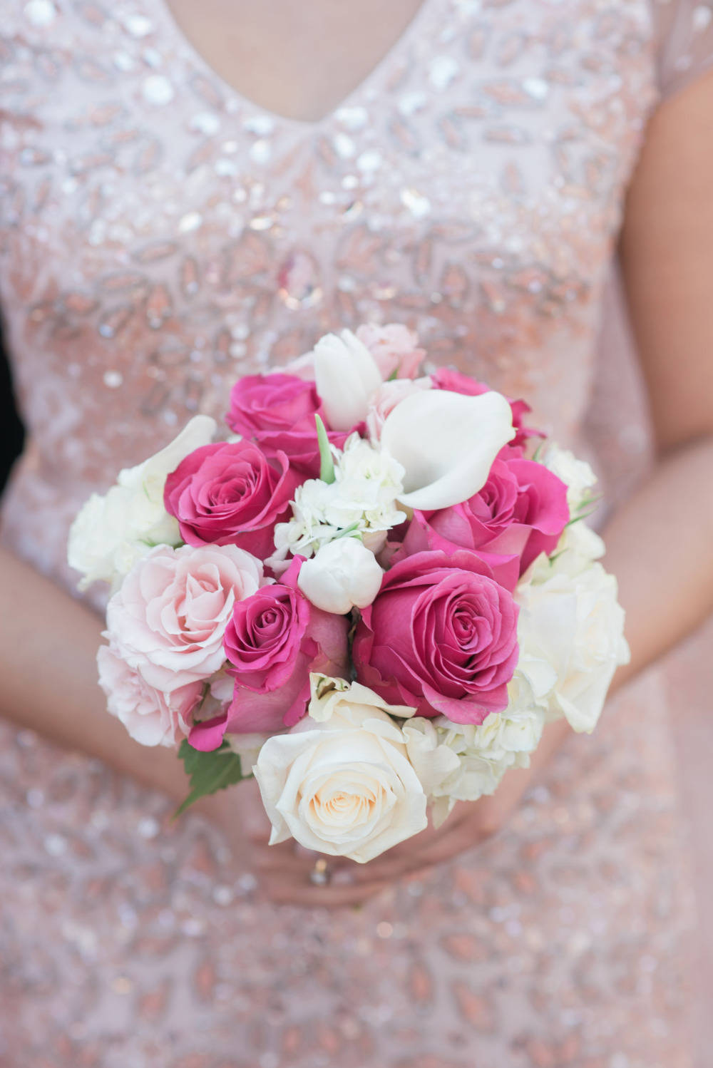 pink and white rose and lily wedding bouquet