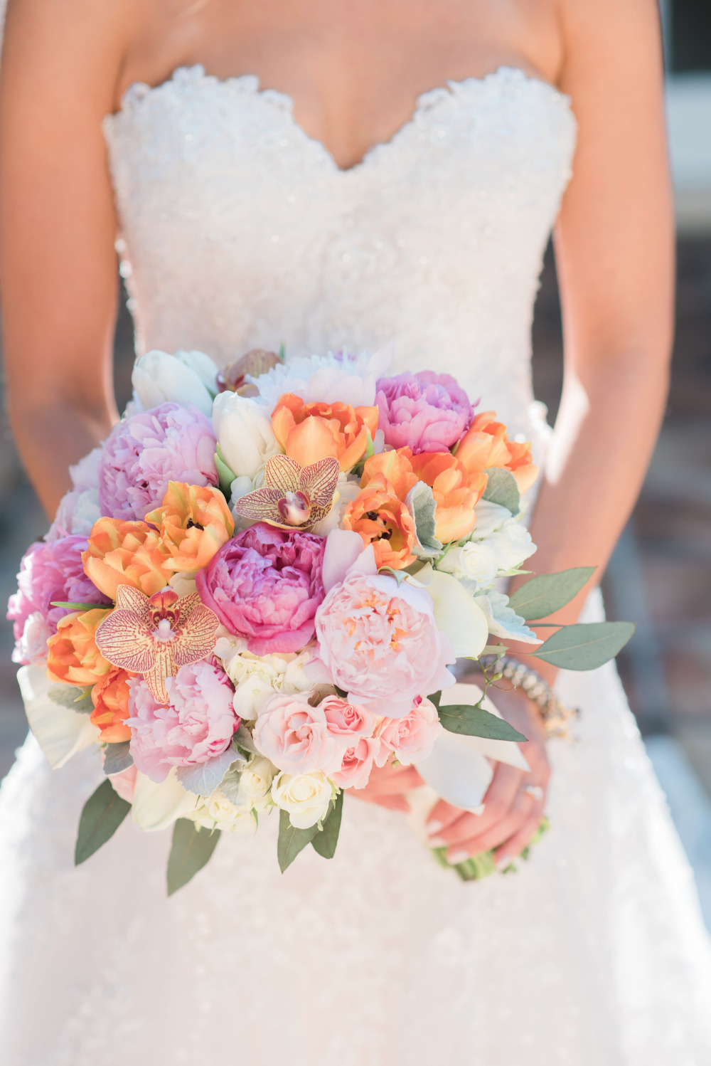 beautiful pink and orange rose and peony and orchid bouquet