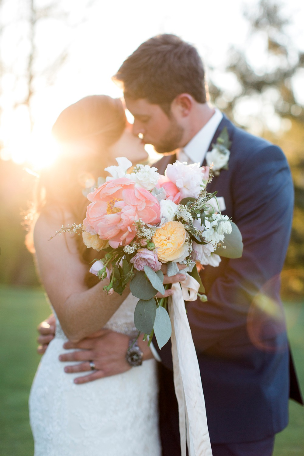 Sunset kiss and pretty bouquet