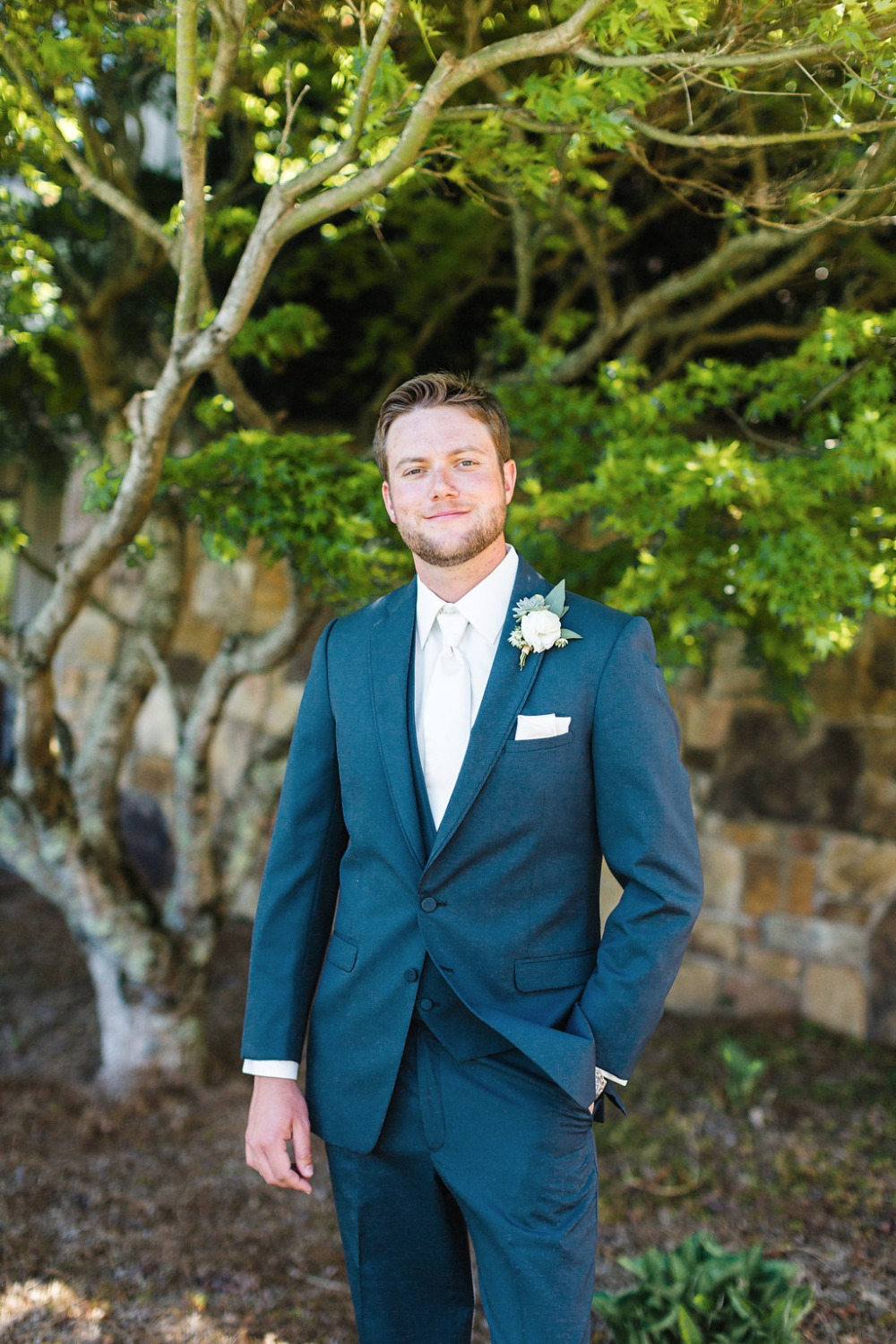 Groom in a Navy suite