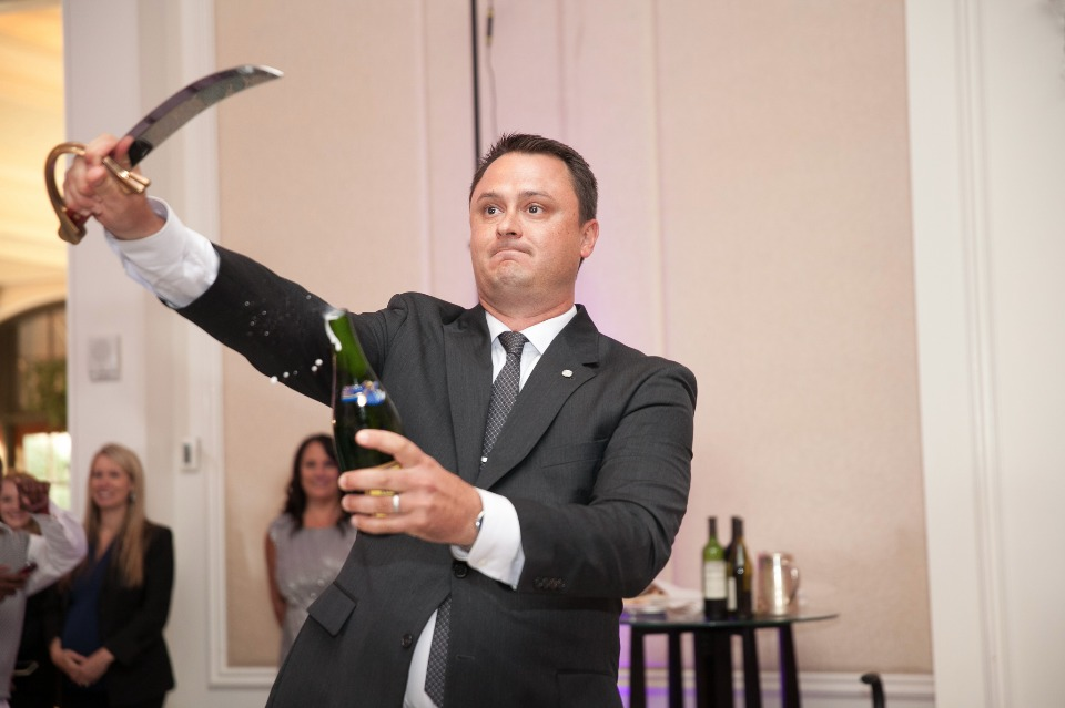 dramatic champagne bottle cutting