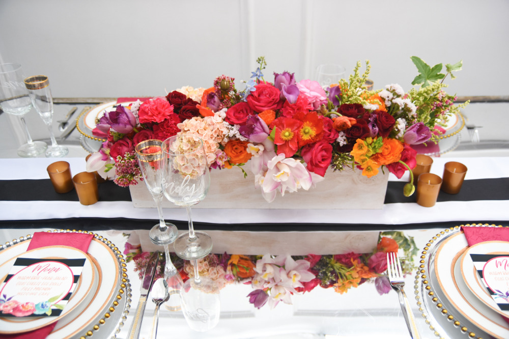 very colorful wedding floral box centerpiece