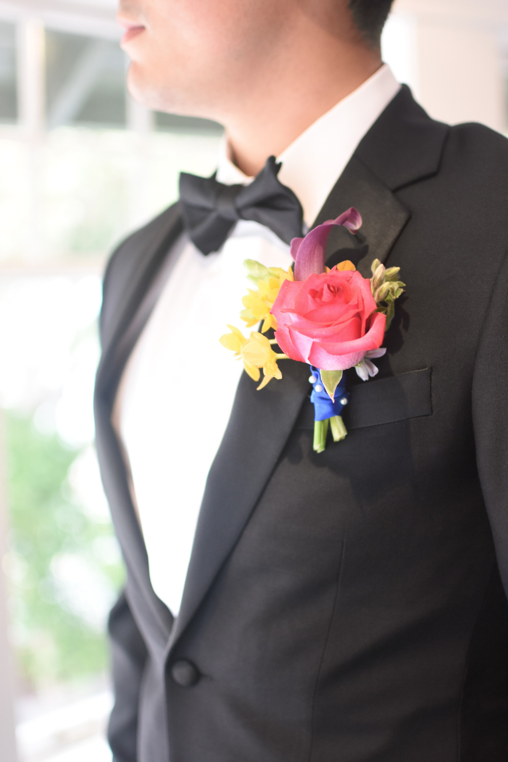 pink and yellow floral boutonniere