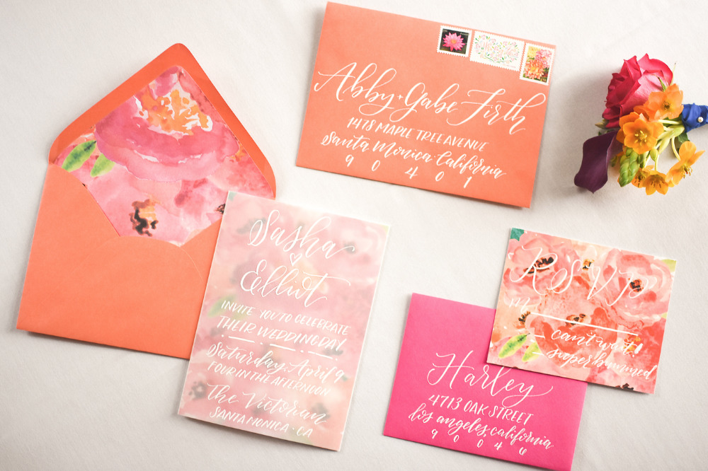 bright pink and orange wedding stationery