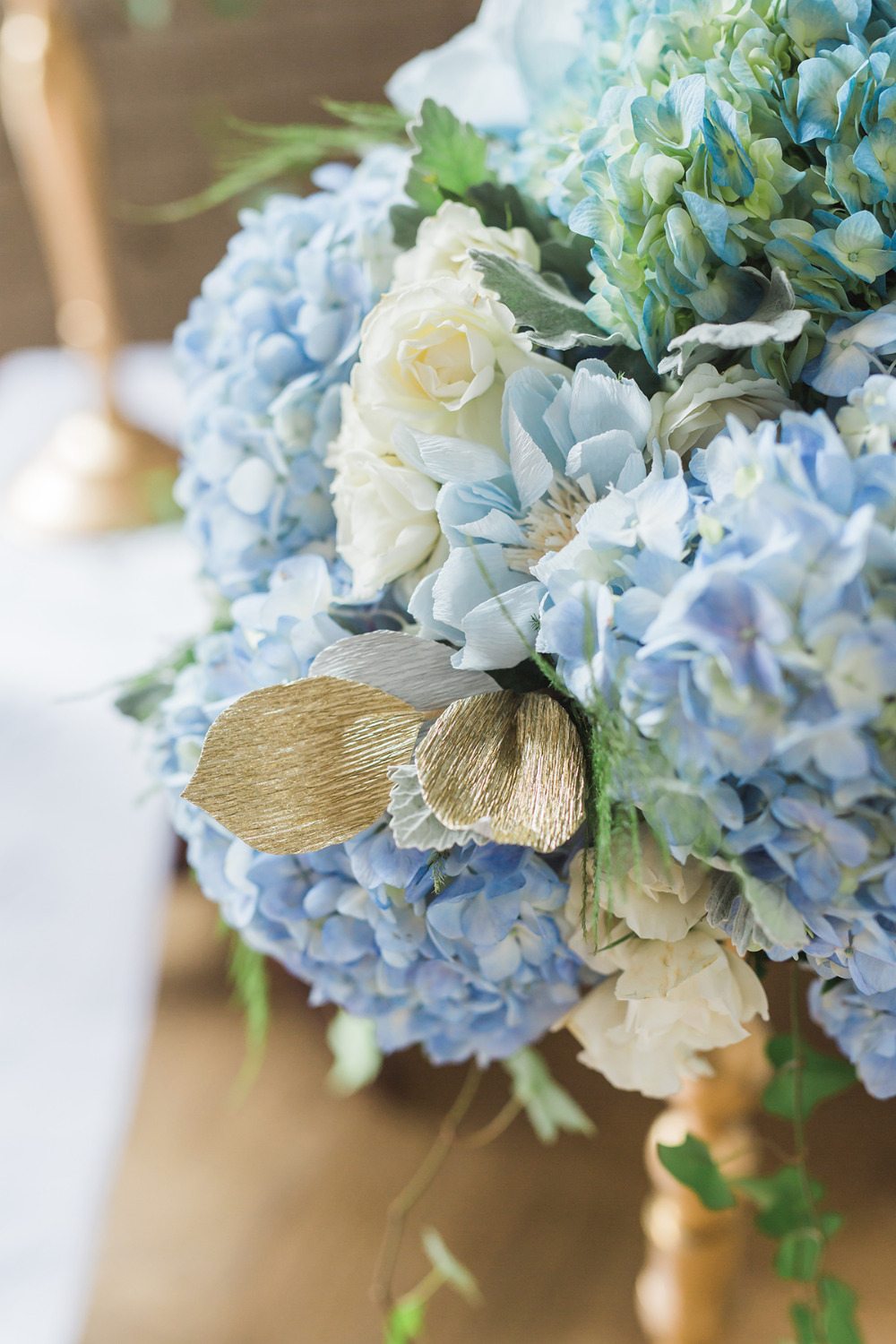 blue crepe paper and real flowers decor