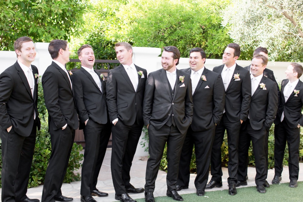 Grooms in black suits