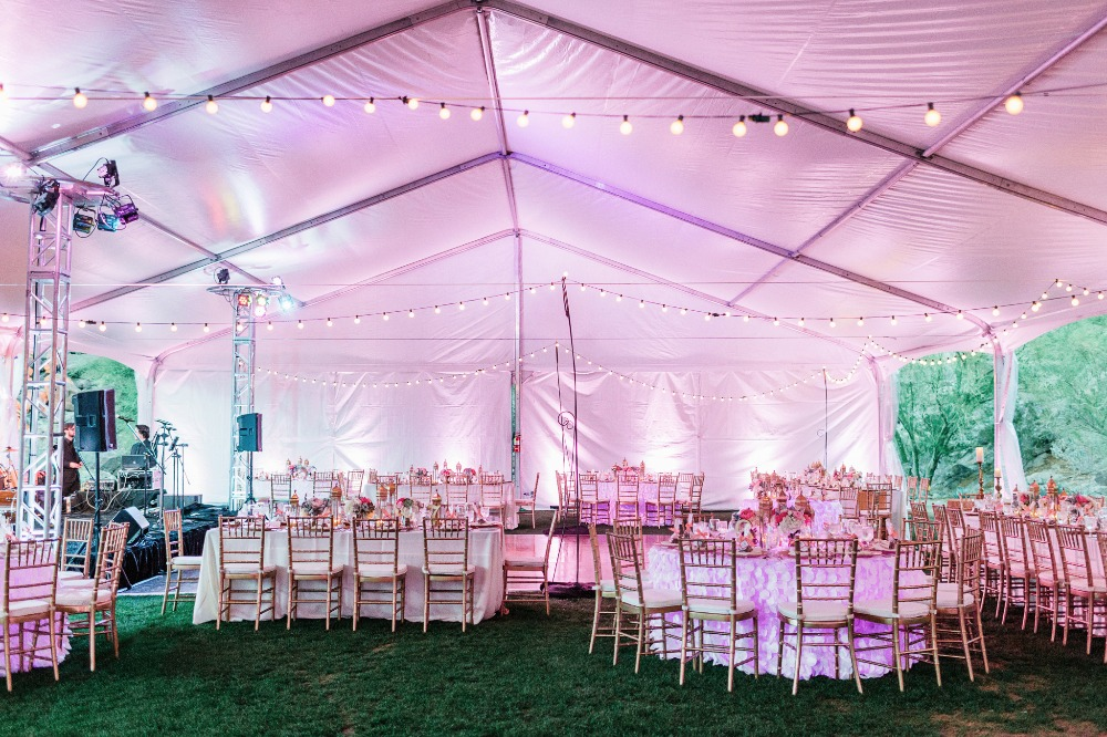 Pink tent reception with string lights