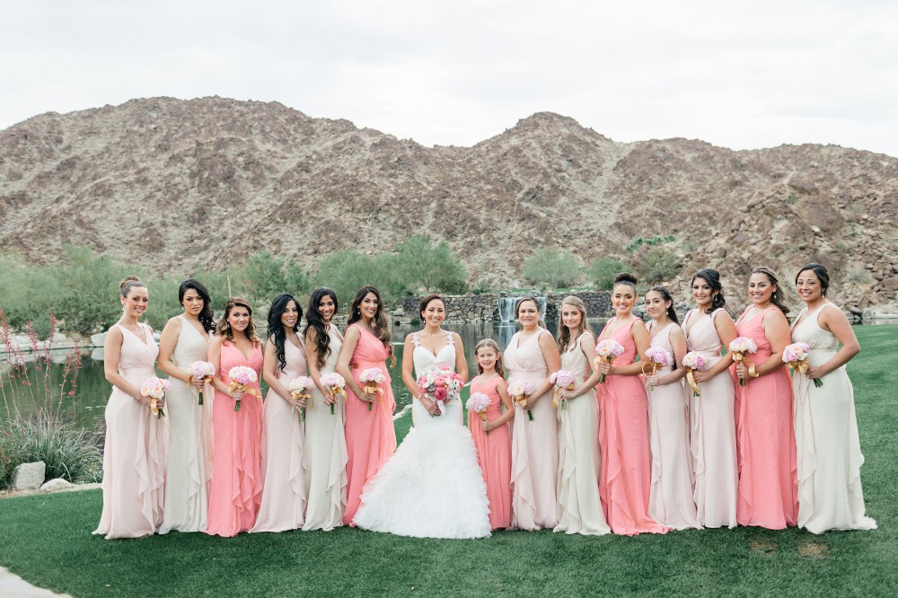 Bridesmaids in blush and coral dresses