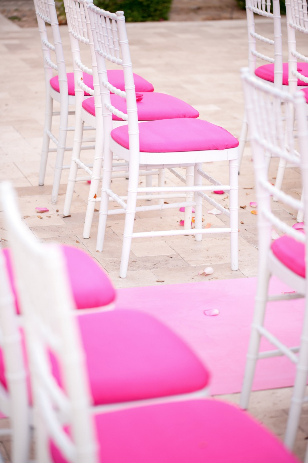 Pink and white ceremony chairs