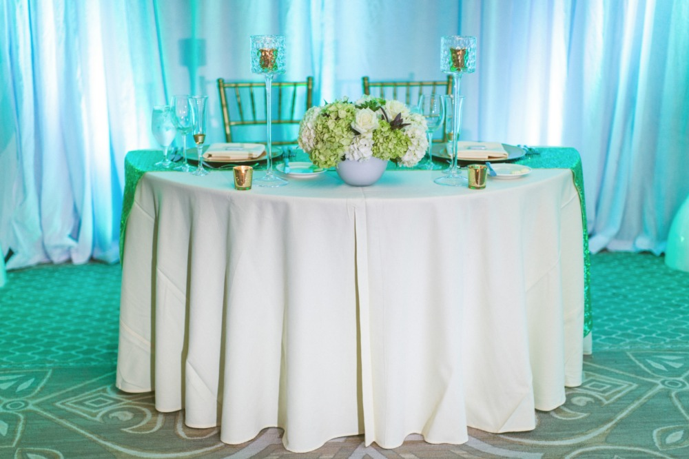 Teal back lit sweetheart table