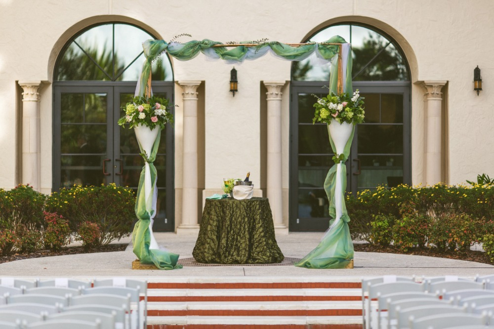 Teal and white wedding arbor