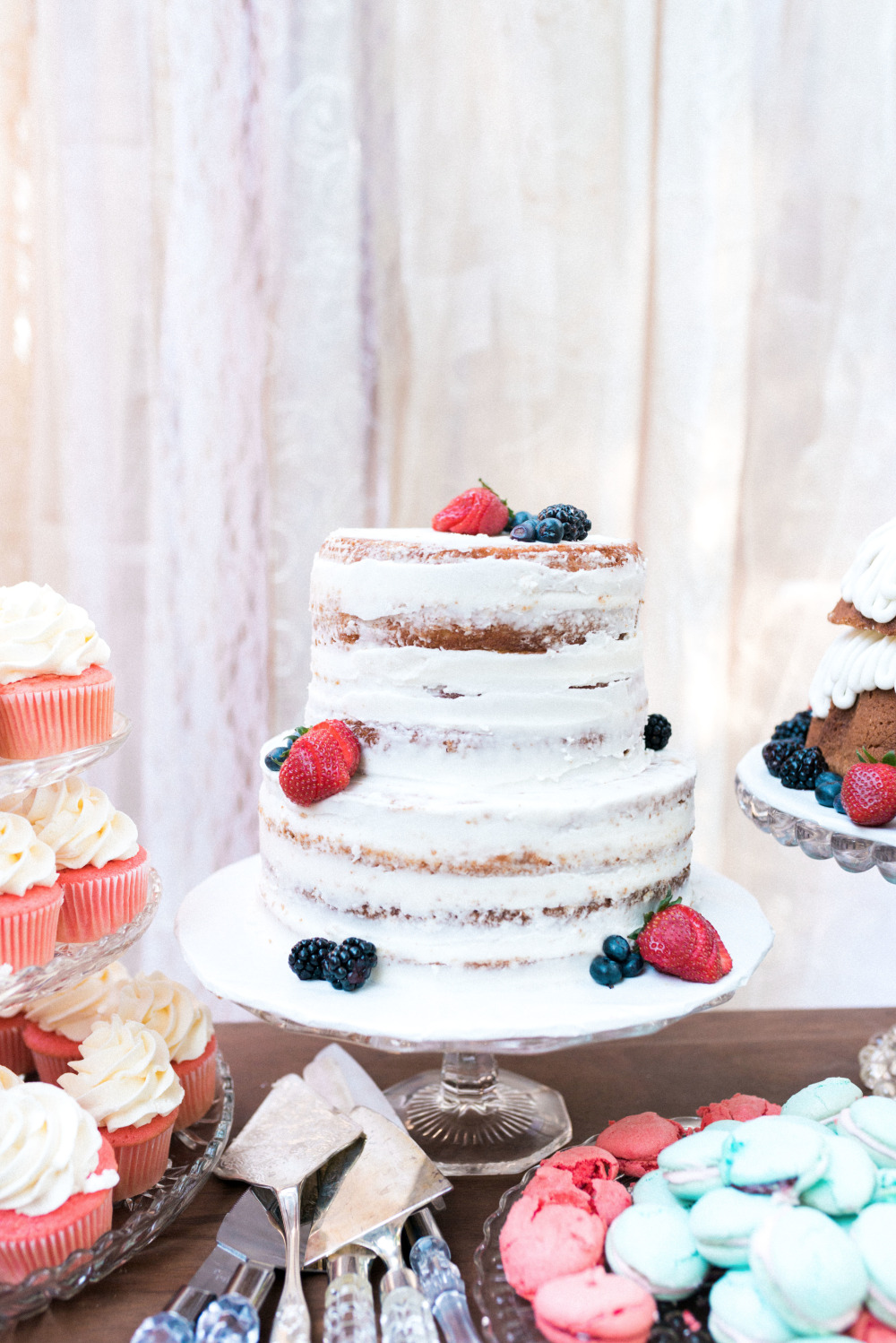 half naked wedding cake with berries