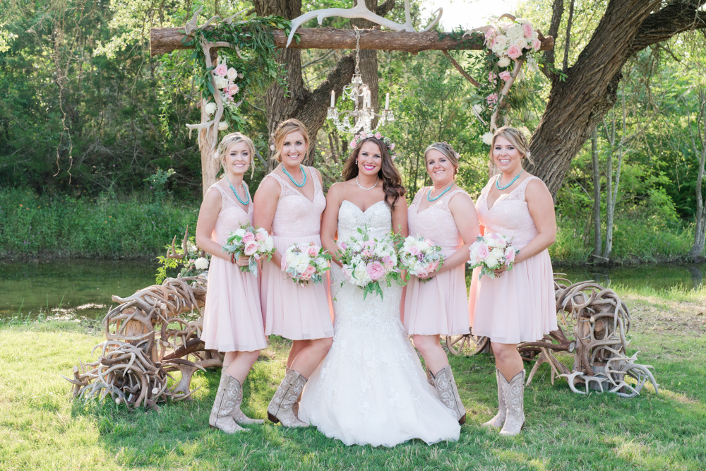 pink bridesmaids with cowgirl boots