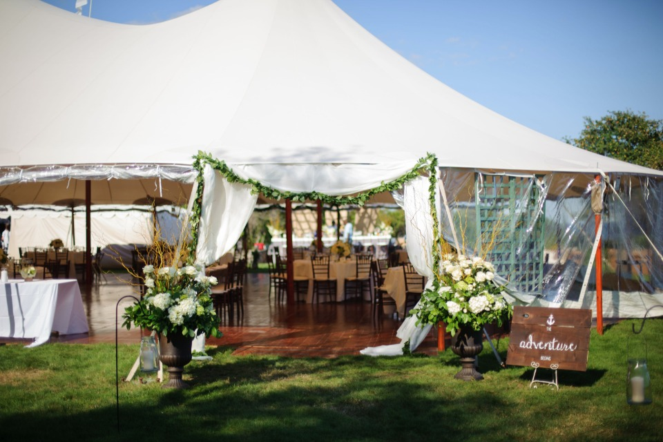 flower accented tent wedding reception entrance