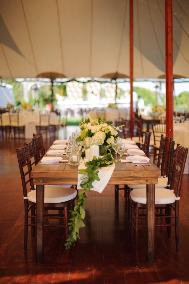 fam table reception with white and green garland centerpiece