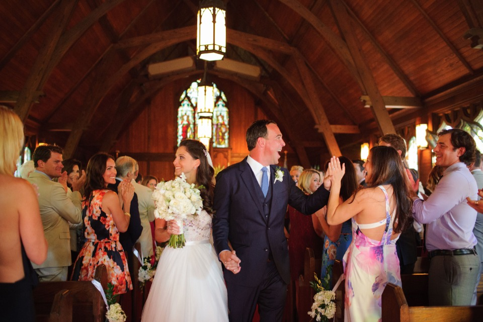 newlyweds being greeted by friends and family