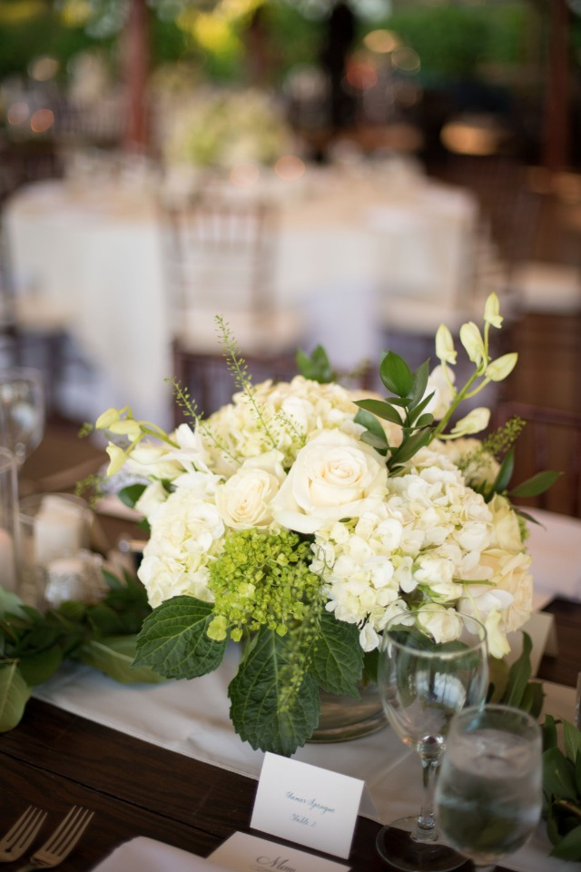 white and green reception centerpiece