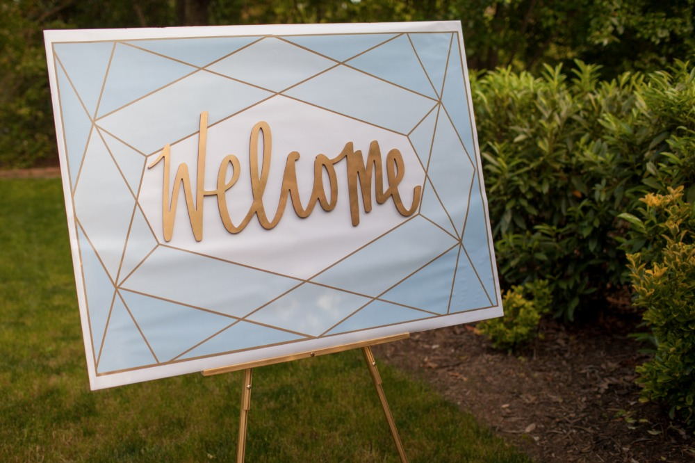Geometric gold welcome sign