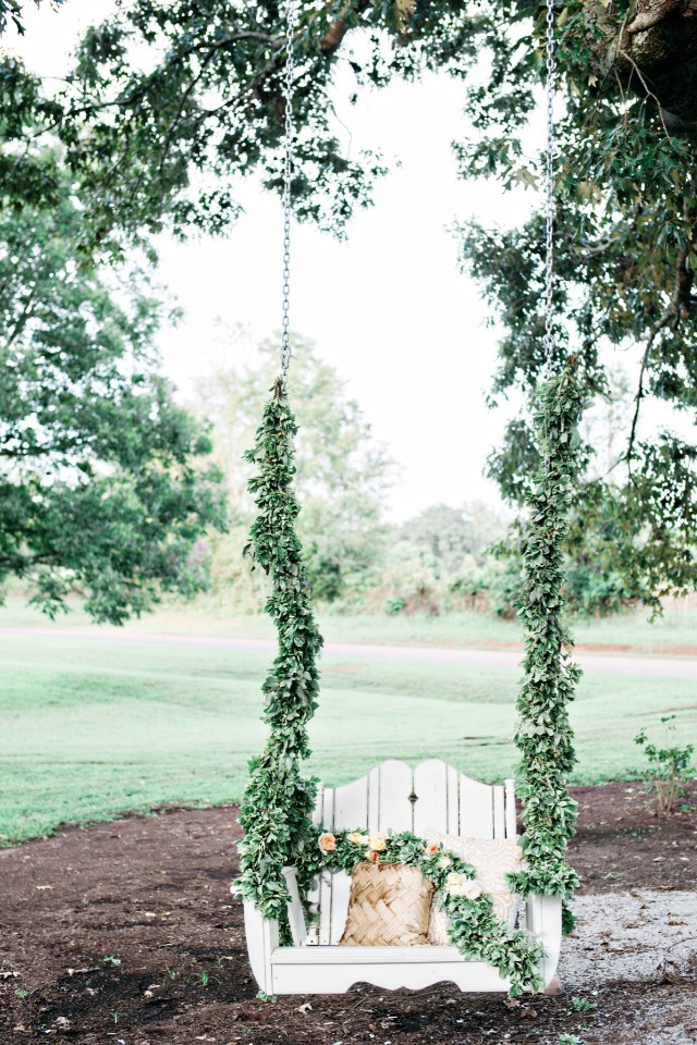 romantic greenery garland draped swing