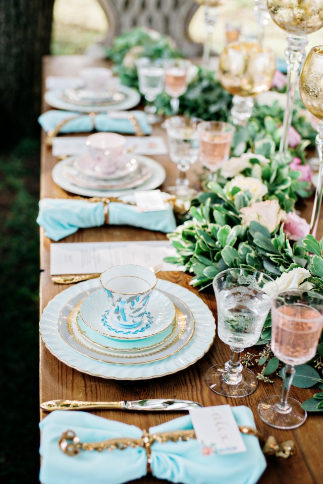 soft blue and light pink with gold accents throughout the garden table decor
