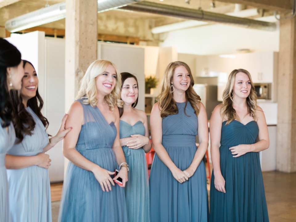 bridesmaids get a first look of the bride