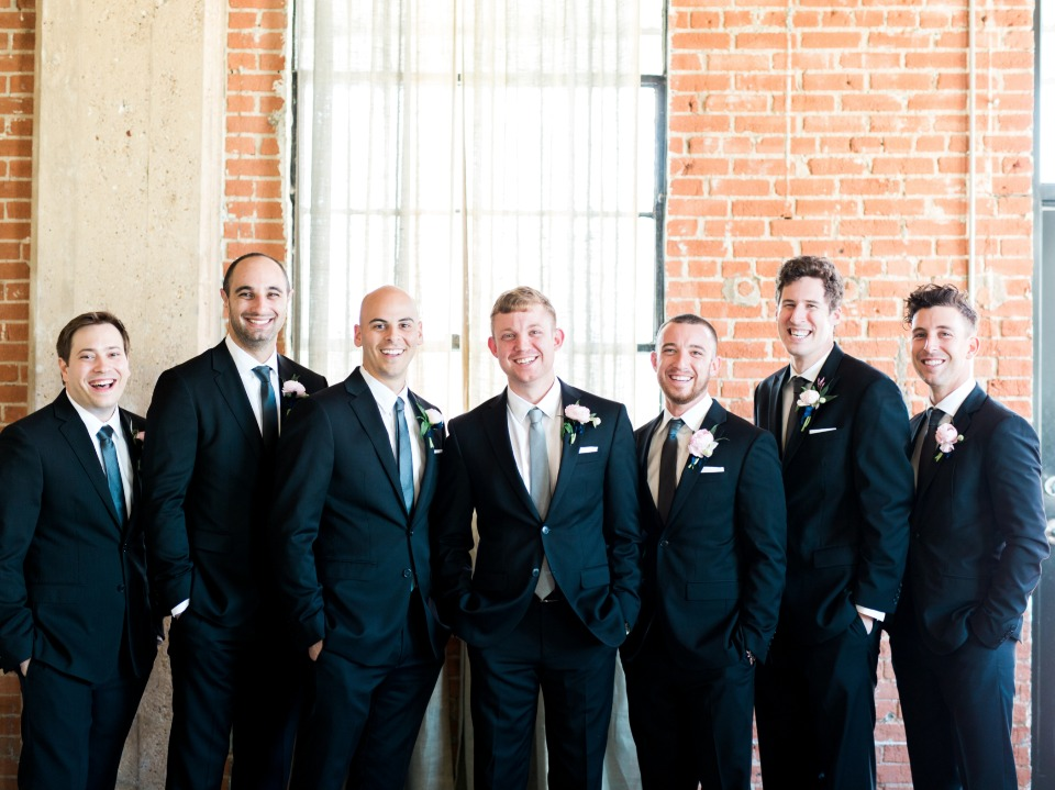 groom and his men in classic black suits and blue ties