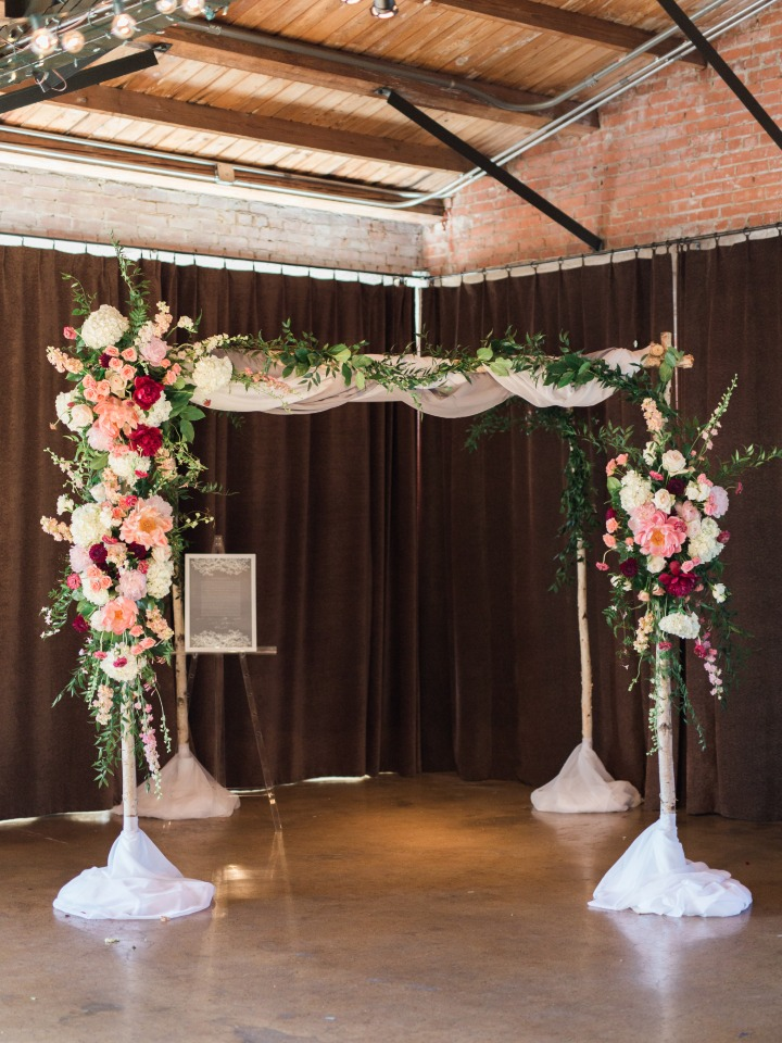 flower accented wedding chuppah for jewish ceremony