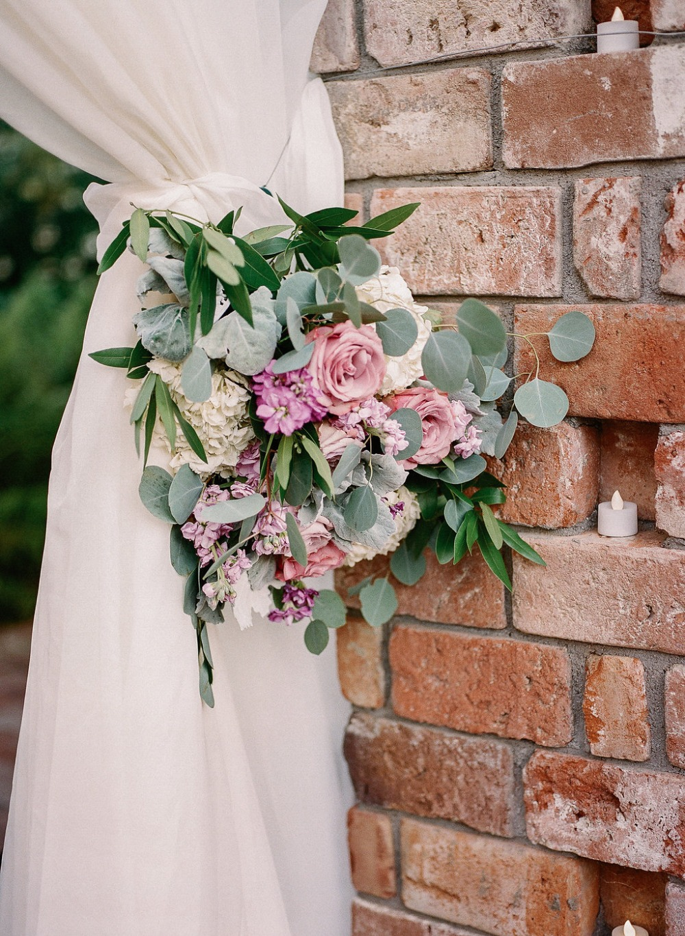 Floral tie back ceremony decor