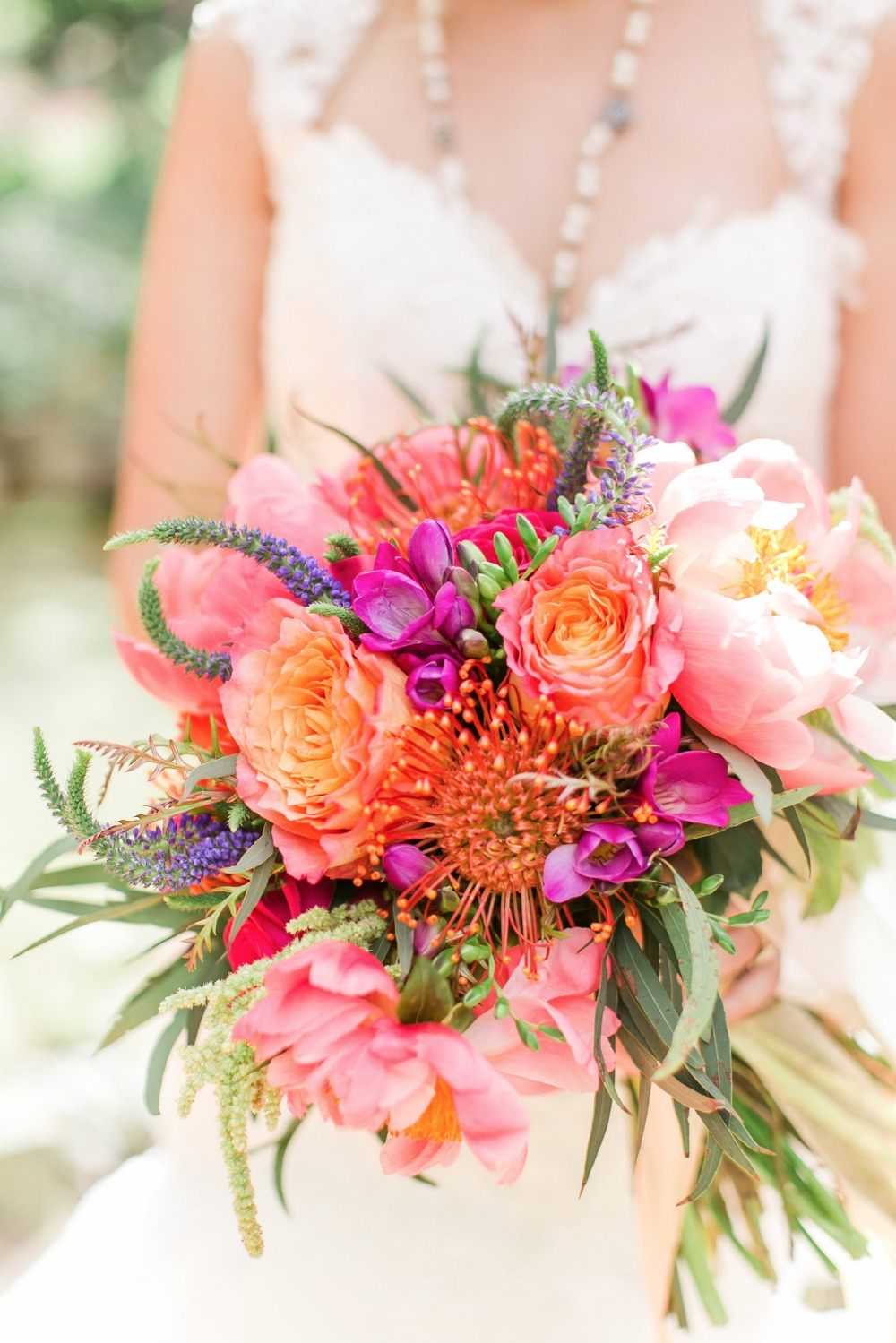 Bright orange pink and peach wedding bouquet
