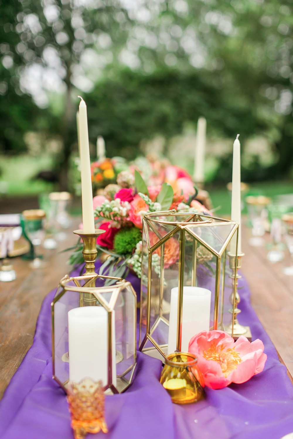 Candle centerpiece and purple table runner