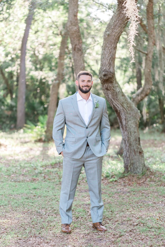 groom in light gray suit from Men's Wearhouse