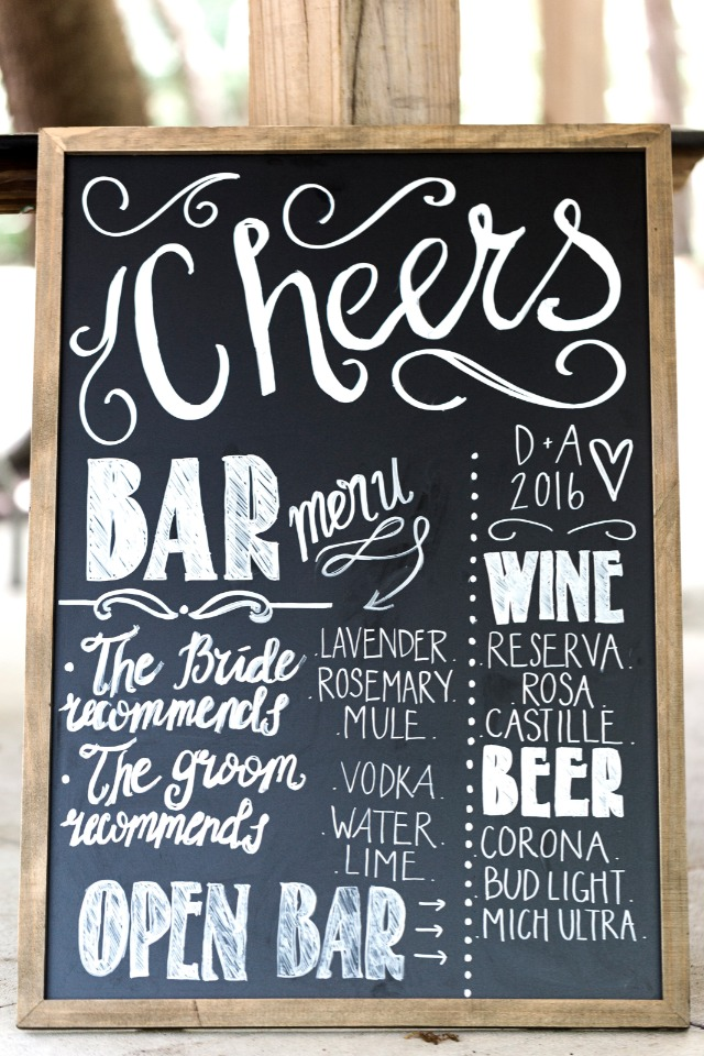 chalkboard bar sign with drink menu