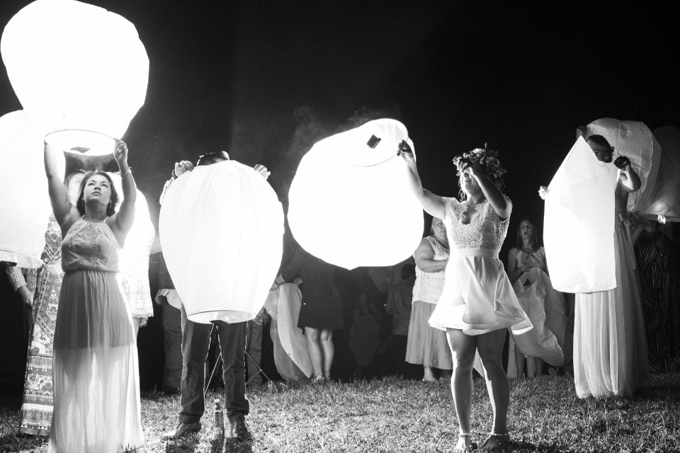 lighting paper lanterns in memory of loved ones