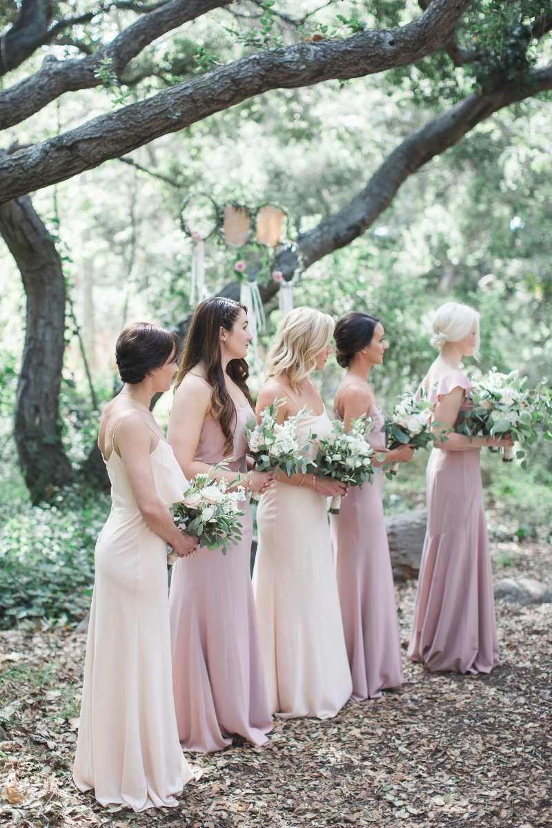 Beautiful, muted pinks and ivories for these gorgeous bridesmaids and their dresses.