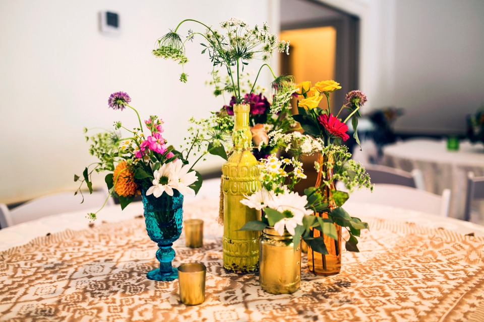mismatched centerpieces with wildflowers