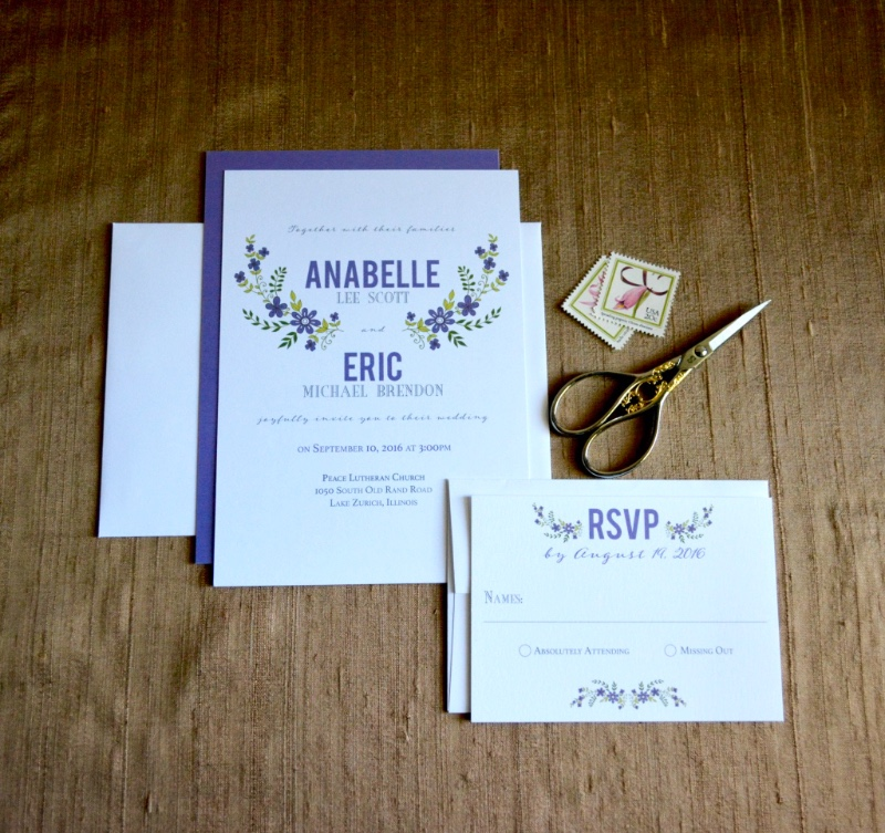 Who doesn't love a whimsical floral wedding invitation suite? This one is purple and green, and oh so sweet. By Lucky Invitations.