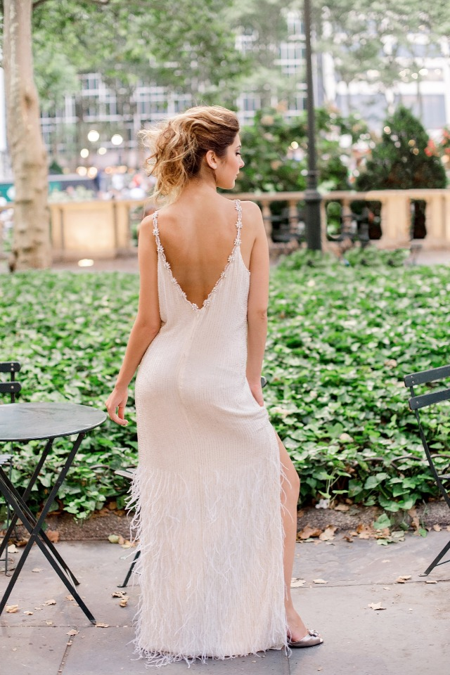 feeling the drama from this deep v cut wedding dress