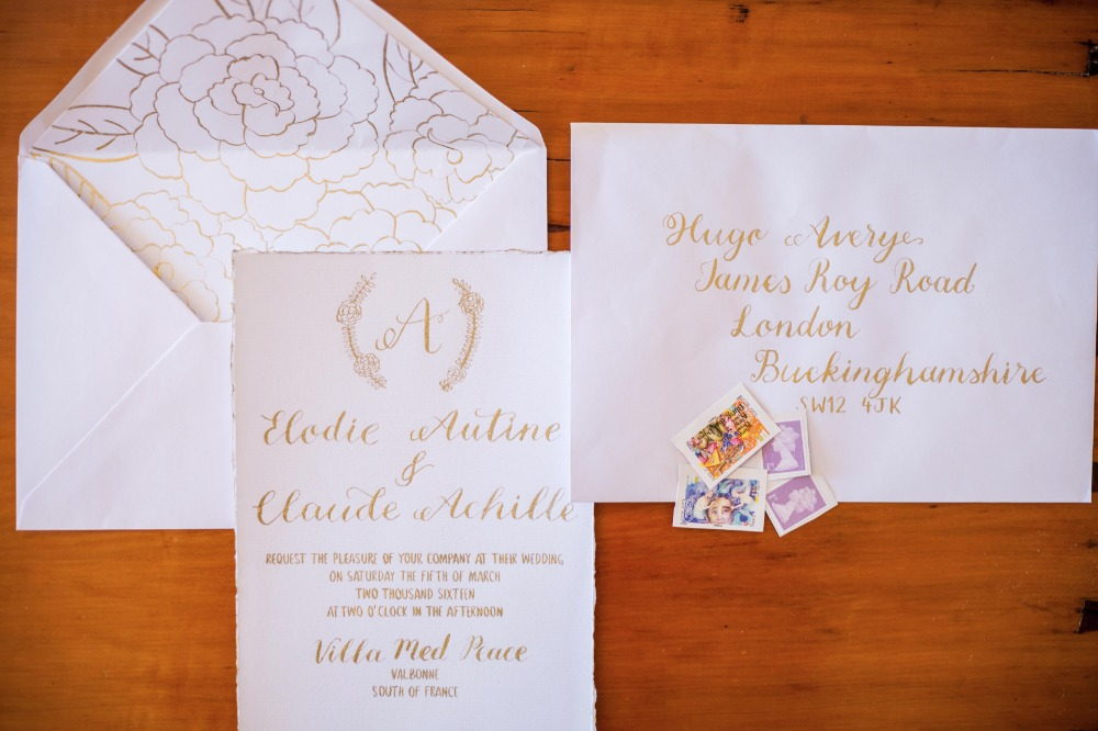 Gold and white calligraphy invitations