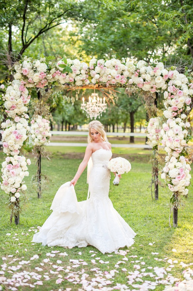 glamorous bride under a glam ceremony arch