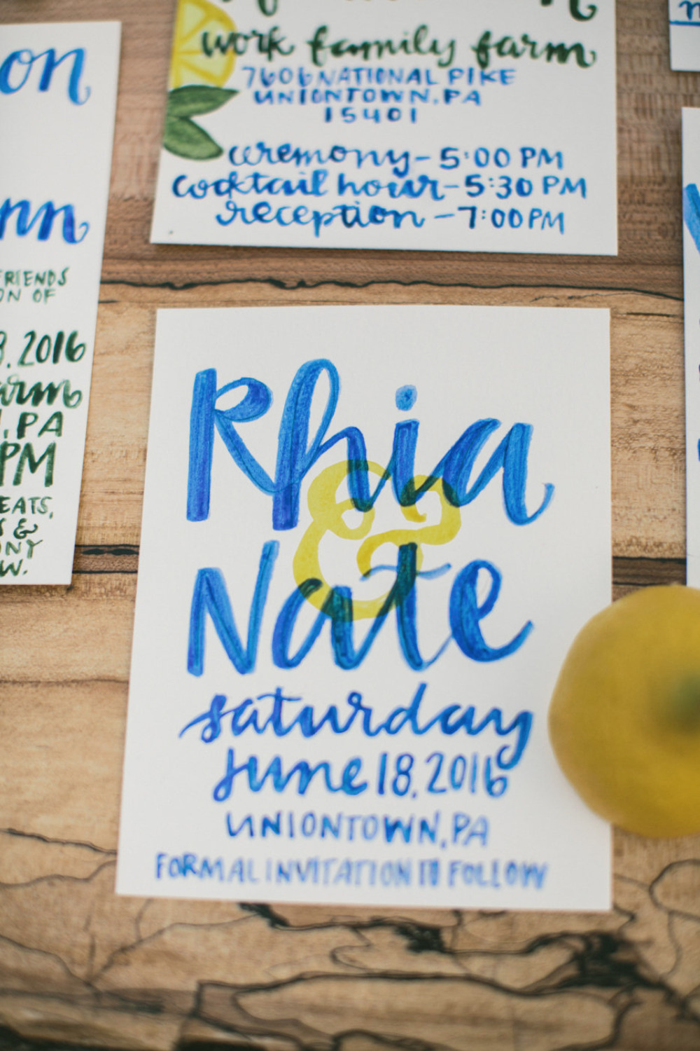 blue and yellow wedding stationery