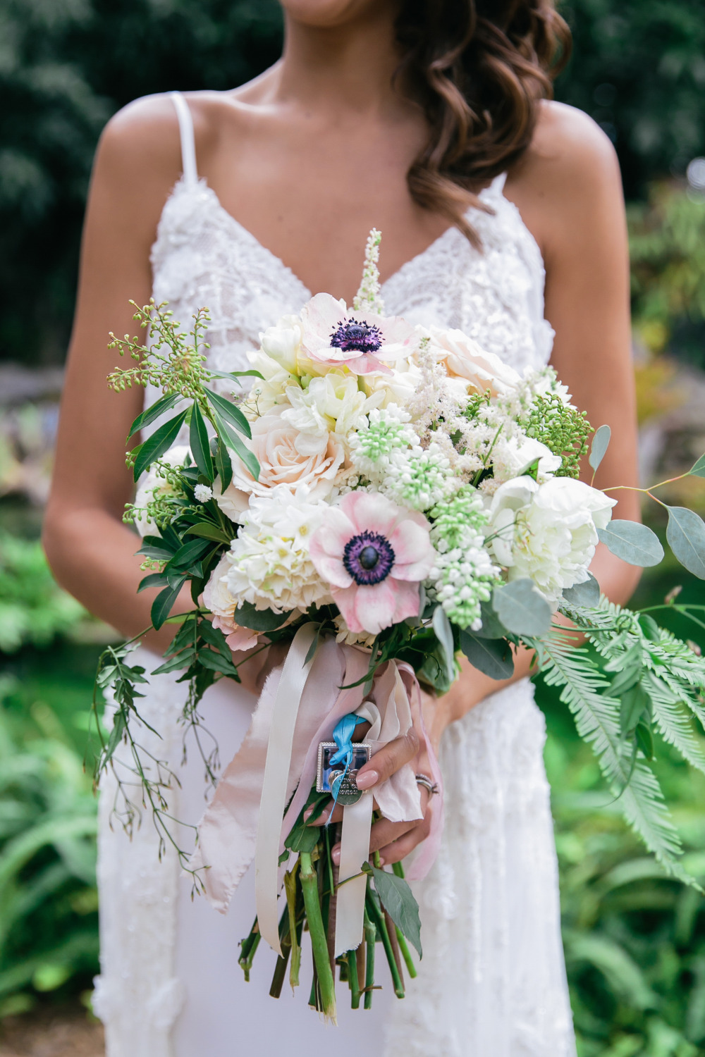 pretty anemone and rose wedding bouquet