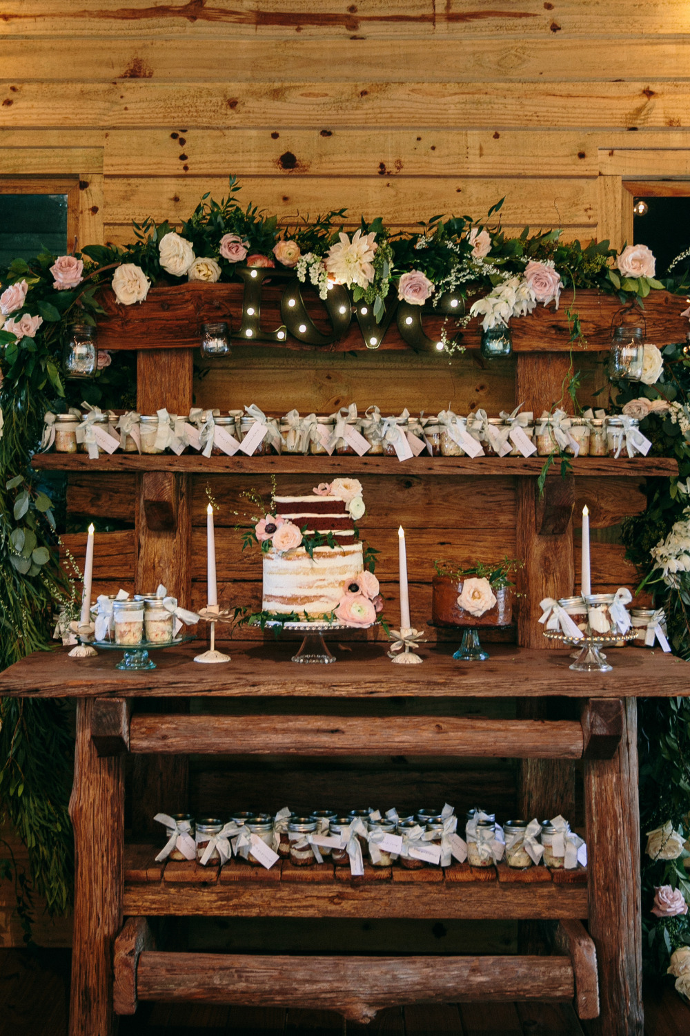 pretty pink floral wedding dessert table