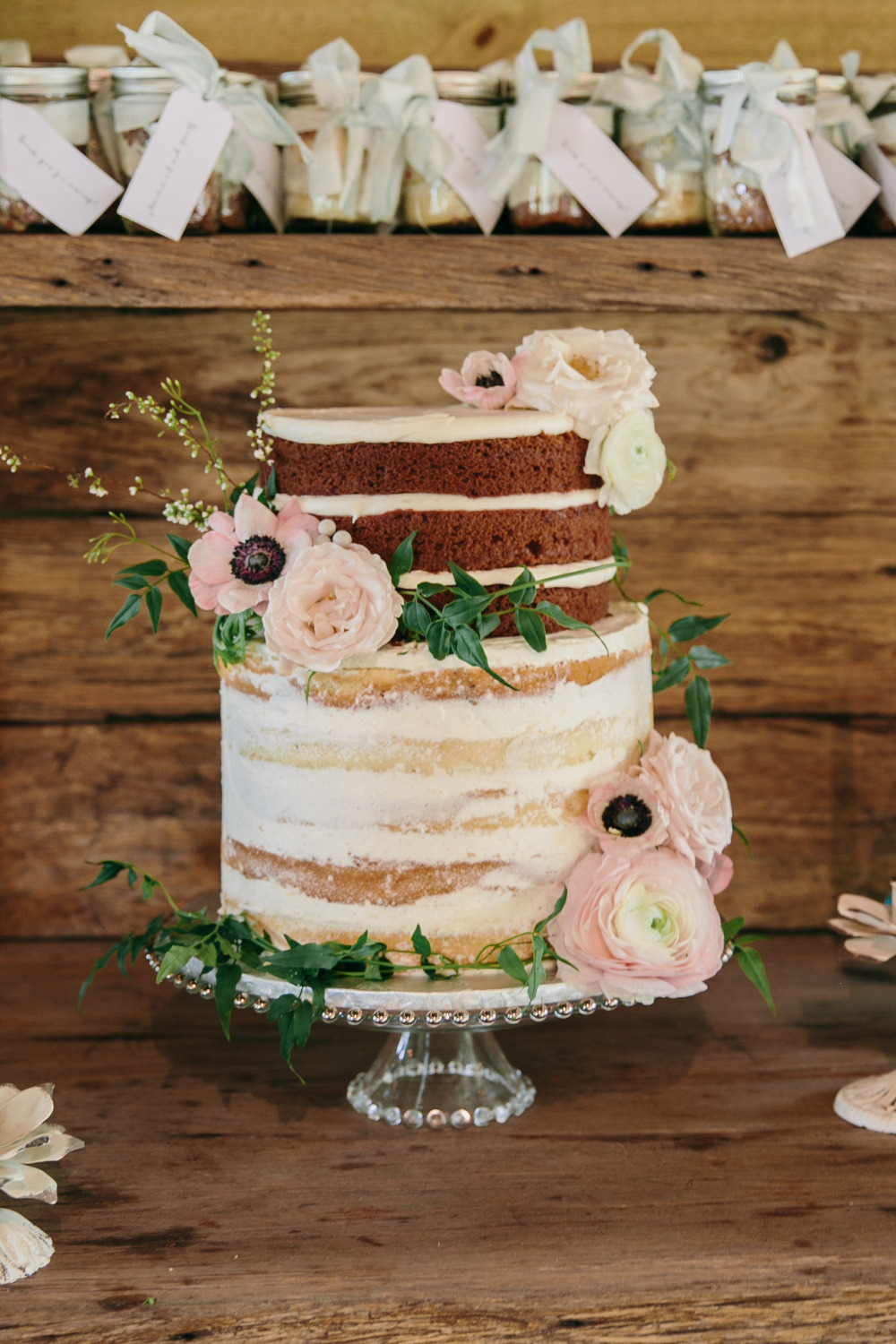 naked cake wedding cake with flowers