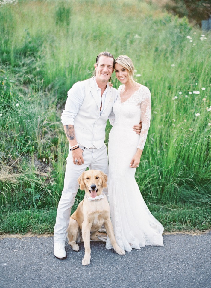 all white wedding couple with their furry little ring bearer